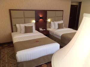 A bed or beds in a room at Desalegn Hotels and Resort