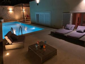 The swimming pool at or near Amazing SeaView luxury villa
