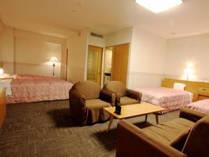 TSUMAGOI度假村 彩鄉房間的床
