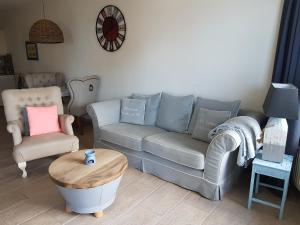 A seating area at Sterflat Appartement