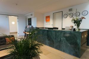 The lobby or reception area at HighPark by Palmira
