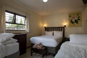 A bed or beds in a room at Angelica Guest House