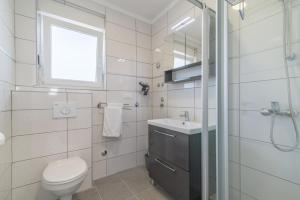 A bathroom at VILA KIKA