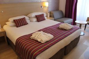 Un ou plusieurs lits dans un hébergement de l'établissement Best Western Plus Hotel Carlton Annecy