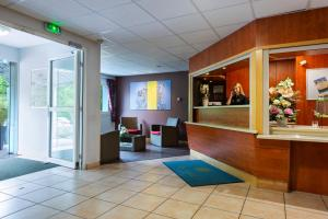 The lobby or reception area at Hotel Roi Soleil - Amnéville