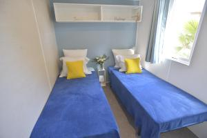 A bed or beds in a room at Sas Robrecht