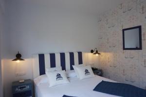 Cama o camas de una habitación en Hotel OMA