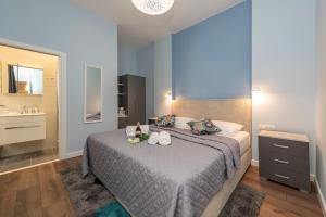A bed or beds in a room at B&A Rooms Zadar