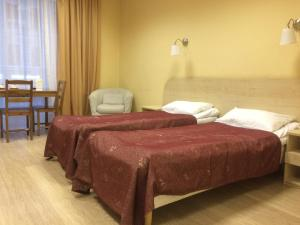 A bed or beds in a room at Bolshoy 45 Hotel