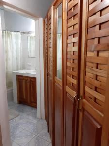 A bathroom at Green's Palace Jamaica