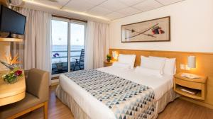 A bed or beds in a room at Iberostar Heritage Grand Amazon - All inclusive