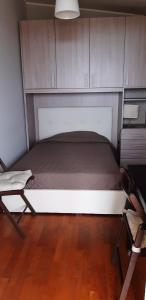 A bed or beds in a room at Le Ninfe Bed and Breakfast