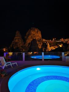 The swimming pool at or near Hermes Cave Hotel