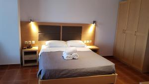 Ένα ή περισσότερα κρεβάτια σε δωμάτιο στο Skiros Palace Hotel