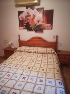 A bed or beds in a room at Pension La Linea