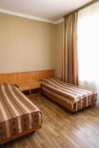 A bed or beds in a room at SeAr