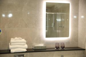 A bathroom at Clarion Collection Hotel Chimney Corner