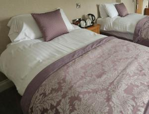 A bed or beds in a room at Clarion Collection Hotel Chimney Corner