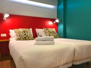 A bed or beds in a room at Hotel Ritual Maspalomas - Adults Only