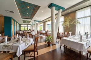 A restaurant or other place to eat at Yantra Grand Hotel