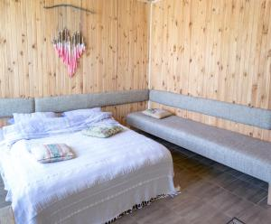 A bed or beds in a room at Baron Munchausen Guest House