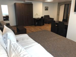 Ein Bett oder Betten in einem Zimmer der Unterkunft City Hotel Tallinn by Unique Hotels