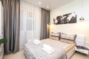 Кровать или кровати в номере 5days-nn, Studio apartment on Burnakovskaya 99