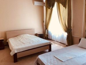 A bed or beds in a room at Hotel Zama