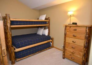 A bunk bed or bunk beds in a room at 12 White Alder Lane