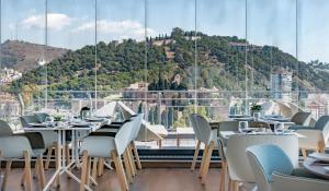 A restaurant or other place to eat at AC Hotel Malaga Palacio