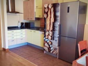 Una cocina o zona de cocina en Apartamento Rural Puente La Reina