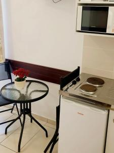 A kitchen or kitchenette at Süle Apartments & Rooms