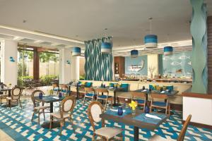 A restaurant or other place to eat at Dreams Dominicus La Romana Resort & Spa