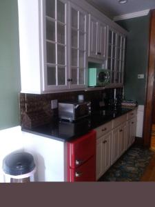 A kitchen or kitchenette at Firehouse Inn