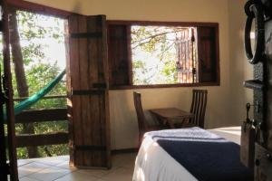 A bed or beds in a room at Chalé do Bosque