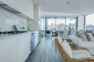 A kitchen or kitchenette at Coogee Luxury Apartments