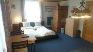 Ein Bett oder Betten in einem Zimmer der Unterkunft Pension Wil