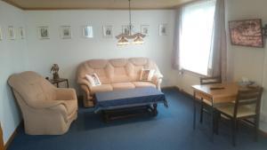 Ein Sitzbereich in der Unterkunft Pension Wil