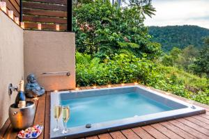 The swimming pool at or near Seclude Rainforest Retreat