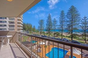 A view of the pool at Columbia Beachfront Apartments on Rainbow Bay or nearby