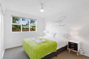A bed or beds in a room at Nobby Beach Holiday Village