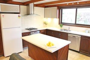 A kitchen or kitchenette at Elegant style Bay of Fires