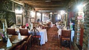 A restaurant or other place to eat at Dun Cow Inn