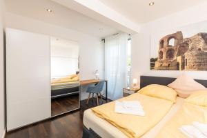 Ein Bett oder Betten in einem Zimmer der Unterkunft Bedas - Residenz an den Kaiserthermen II