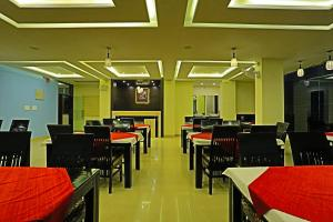 A restaurant or other place to eat at Suraj Palace