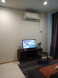 A television and/or entertainment center at Apartment at Punnawithi BTS