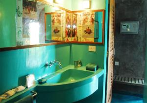 A bathroom at The Dune Eco Village and Spa - Pondicherry