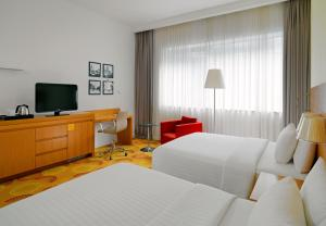 A television and/or entertainment center at Courtyard by Marriott Budapest City Center
