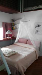 Letto o letti in una camera di a casa di Marzia