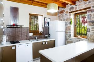 A kitchen or kitchenette at Important Group   BD416 High Privacy 2 Bedroom Villa in Bitez